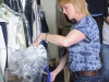 WCK-Cleaners-employee-sorting-dry-cleaning